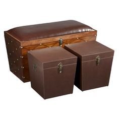 Hermitage Storage Trunk - 3 Piece Set - This is where the games, the odd pillow, or extra bedding are handsomely stored. The Hermitage walnut storage trunk is really a trio of storage and seating. Comfy seating for the larger size, secure odds and ends in the smaller cubes. Rich brown faux leather upholstery and antique brass nailhead trim accent this exquisite piece.