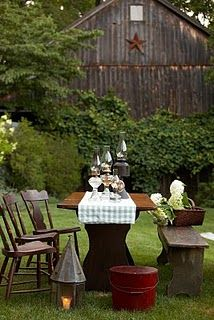 Tablescape with a beautiful barn as the backdrop.