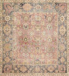 Seventeenth Century Isfahan Carpet in tones of indigo, taupe, burgundy, and sand