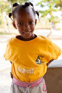 Our students in Haiti wearing the educational HFHF t shirts