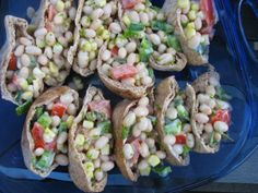 Pitas stuffed with white bean salad