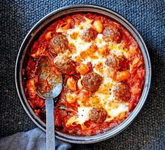 This recipe has all the elements of comfort food; beef and pork meatballs with an oozing cheesy filling, a rich tomato sauce and pasta