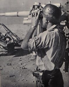 DAK/Afrikakorps Observor watching , making a speedy assessment then reporting through his chain of command a post combat situation