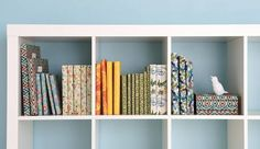 Cover books with pretty paper so they match in a shelf! Why the heck did I not think of this??