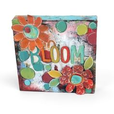 Bloom Flowers Canvas   Creativity blooms with this mixed-media masterpiece. Simply follow the instructions below to create this floral project using the Homegrown & Handmade die collection by Stephanie Ackerman.  Artist: Stephanie Ackerman