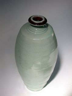 Ceramics by Bridget Drakeford at Studiopottery.co.uk - Celadon faceted vase, 2008.