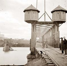 """This picture was taken in 1864, during the Civil War. It shows a fortified bridge over the Cumberland river near Nashville, Tennessee. Perhaps similar to the bridge that Ambrose Bierce described in his story """"An Occurrence at Owl Creek Bridge."""""""