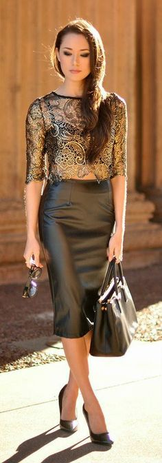 Sexy black leather skirt with gold lace blouse, black bag and heels
