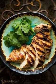 Skinless boneless chicken breasts marinated in yogurt with garlic, cumin, and paprika, then grilled. 5 minutes prep, marinate a few hours, then grill. So EASY! The yogurt marinade perfectly tenderizes the chicken. On SimplyRecipes.com
