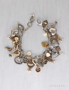 This one of a kind bracelet is full of vintage sterling silver and brass charms in a love theme. It was inspired by vintage heirloom bracelets whose owners collected and added charms over years and years. This bracelet has many different styles of hearts mixed with flowers, a couple of cupids and a sweet little bird. Many of the charms have been drilled and/or embellished with sparkly rhinestones and small genuine pearls.The charms are securely attached with brass jump rings to embossed ...