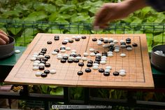 Go, a Japanese strategy game, I'm willing to teach anyone who wants to learn.