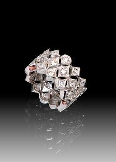 Custom Designed: Ornate platinum and diamond wide band