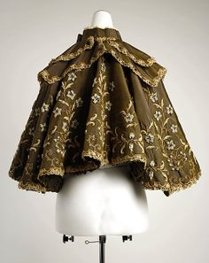 Opera cape (rear view) Beer (French) Designer: Gustave Beer (French) Date: ca. 1896 Culture: French Medium: silk, wool Dimensions: Length at CB: 19 in. (48.3 cm) Credit Line: Gift of Everett S. Lee, 1980 Accession Number: 1980.588.1