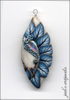dichro Leaf Fan in polymer clay. so pretty Polymer Clay Canes, Polymer Clay Necklace, Polymer Clay Pendant, Polymer Clay Projects, Polymer Clay Creations, Clay Crafts, Clay Earrings, Metal Clay Jewelry, Clay Design