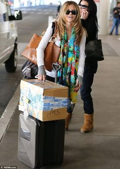 Celebrity Scarf Watch: AnnaLynne McCord arriving at LAX wearing a lovely colourful scarf and white lacy cardigan.
