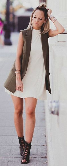 Sleeveless vest trend + stylish + pair of strappy gladiator-style sandals + Megan Anderson + edgy and alternative + cute khaki outfit Dress/Vest: TopShop, Shoes: Forever 21, Bag: Chanel.