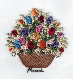Hand embroidered tulip basket by Pilar Marzal. Visit website to view more gorgeous examples.