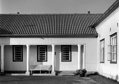 Alajärvi Municipal Hospital by Alvar Aalto: As built, it differed considerably from Aalto's drawings: notably, the two Italian piazzas with ornamental fountains and colonnades linked with the sauna and shed buildings disappeared. The most remarkable elements of the completed building were the loggia at the front, supported by 4 columns, and the hall, with column motifs and an ornamental window overlooking the lake (later replaced by a door to a new wing).