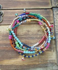 Colorful rainbow ombre skinny 4x wrap bracelet by slashKnots