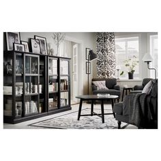 Ikea: A living room furnished with dark grey armchairs, a black coffee table and two black glass door cabinets with sliding doors. Buffet Vitrine, Armoire Buffet, Living Tv, Ikea Living Room, Home And Living, Living Room Furniture, Living Rooms, Furniture Sets, Bedroom Ideas