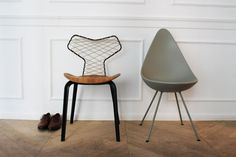 Fritz Hansen | The Grand Prix (left) and Drop chair (right) side by side in the Fritz Hansen showroom during Milan Design Week 2015.