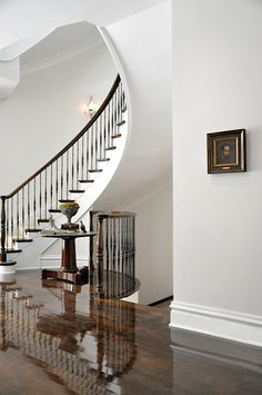 Today's post features an east coast Georgian Estate designed by Kathleen Clements and Briggs Edward Solomon…I thought this home would be an interesting comparison/contrast to yesterday&… Foyer Staircase, Entry Stairs, Staircase Remodel, Spiral Staircases, Curved Staircase, Entry Hall, Hardwood Floor Colors, Dark Wood Floors, Wood Flooring