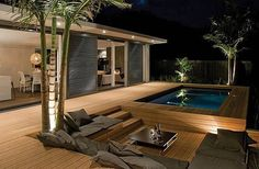 sleek outdor patio with modern wooden deck