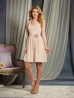 Alfred Angelo Style 7370S: short cocktail length bridesmaid dress with V-neckline and dramatic racer back detail. The waistline is accented with a small belt and a beaded bow.