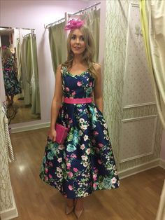 Pretty pink, white and blue floral pattern on a navy background. Sleevless fitted bodice with a round neck. Bright pink belt on the waist. Full calf l Occasion Wear, Special Occasion Dresses, Pink Belt, Midi Dresses, Summer Dresses, Fitted Bodice, Bright Pink, Fashion Boutique, Pretty In Pink