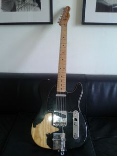 """Nick's Gear. * """"Old Black Dog"""" Tele (U.S.A., Serial number: S8 46692 / 1981)  Purchased in Soho London. Nick says: """"It's my first electric guitar! I've never played a gig or made a record without this guitar...in fact I don't wanna play another guitar. The """"Black Dog"""" is my companion for all these years"""".  Guitar Tech: Adonis Goulielmos - Black / Black pickguard - Ash body (a very heavy one!)  - Maple neck - Seymour Duncan's Antiquitty II 60's Twang pickups - Fender Custom Shop Vintage Pat…"""