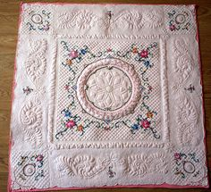 Wholecloth linen quilt by Sue Jennings.  She used The Ultimate Circle stencil to draft her medallion.