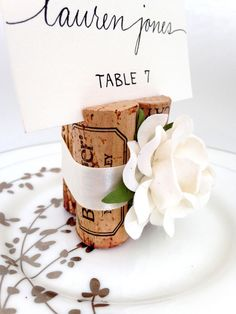 Rustic wedding reception table décor. We made these custom Table Number Holders from our classic 3-cork Place Card Holders. Visit us & discover your custom set today! www.karasvineyardweddingshop.com