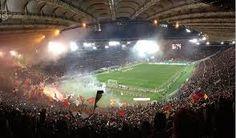Allo stadio Olimpico di Roma assistete ad una partita del campionato italiano di calcio.  At the Olympic Stadium in Rome to attend a match of the Italian football championship.