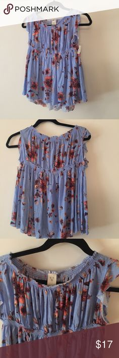 We the free by free people floral blue top Xsmall In Great condition, no rips or stains, super cute flowy top. Sorry no trades or modeling. Pictures are part of description. Please let me know if you have any questions. Thanks for looking. Have a nice Day. Free People Tops
