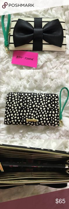 Betsey Johnson Cream and Black Travel Wallet Betsey Johnson Cream and Black Travel Wallet.   Brand new with tags.  So girlie.  Cute idea for a gift.  Perfect size for your belongings without having to carry your handbag. Great way to store your cc, ID, phone, lip gloss, etc.  You can also use as a wristlet ( gorgeous Tiffany blue Aqua) and if you like to carry a large handbag, place this inside to keep you organized during the day and use for the evening. Betsey Johnson Bags Travel Bags