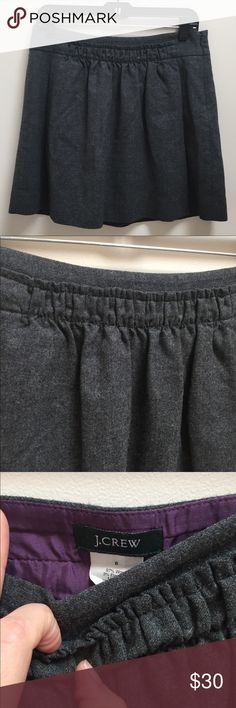J. Crew dark grey pleated mini skirt Awesome skirt! In a great neutral color to wear all year long. Great with tights for fall/winter. J. Crew Skirts Mini