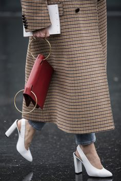 This top handle bag is the it bag of the season. See on street-style stars everywhere, it'll be sure to elevate your look. We love this double handle red folded clutch.