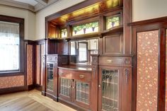 Gorgeous built-in buffet from a 1910 home in North Minneapolis I recently sold. Although this is a little late for the Victorian era, it's certainly a beauty! Built In Buffet, 2 Story Houses, Stained Glass Windows, Victorian Era, Built Ins, China Cabinet, Building A House, Woodworking, The Originals