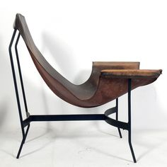 William Katavolos; Enameled Metal and Leather Lounge Chair for Leathercrafter, 1960s.