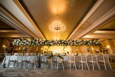 The ballroom set up for a wedding reception at the St. Regis in Atlanta. Andy Beach & Co. florist.