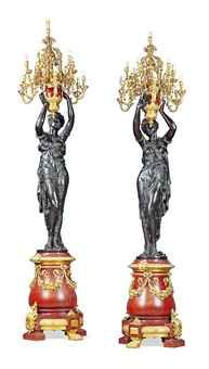 A PAIR OF MONUMENTAL ORMOLU, PATINATED BRONZE AND ROUGE GRIOTTE MARBLE TWELVE-LIGHT FIGURAL TORCHERES