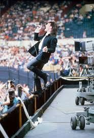 U2 Live Aid 1985 - my birthday, also - if you weren't around at the time, it's hard to explain.  U2 showed a lot of promise, but was about as big as Death Cab for Cutie is now - then they played at Live Aid in front of millions, and overnight became one of the world's biggest bands. Charisma.