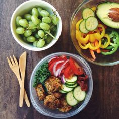 albeeats: Today's lunch & snacks — baked falafel, kale, fresh + sundried tomatoes, red onion, and cucumber with grapes and veggies on the side