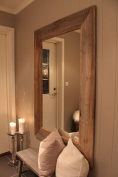 DIY Wood Mirror. Link is not in English, and no picture tutorial. Just a cool picture! :)