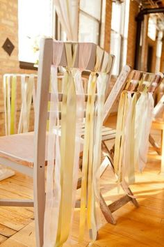 Great look for back row of chairs at outdoor ceremony....love how easy they just loop the ribbon over the backs doubled...very easy for reuse later
