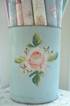 "Beautiful Storage Idea, to which I have my own version as well . a vintage metal wastebasket with floral motif painted on it filled with vintage wallpaper. (photo by by ""such pretty things"" aka Jessica Enig)"