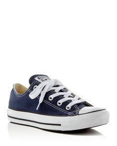 On-trend since before you were born, Converse's sporty low-top sneakers provide a colorful canvas that brightens almost every look. | Canvas/rubber | Imported | Fits large, order half size down  | Lac