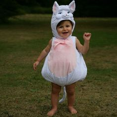 A soft white plush Cat padded suit with a cute tail, this style has a popper fastening with cotton lining. Included is a cat hat with lovely embroidered features. Available in sizes from 3-6 months, 6-12 months and 12-18 months www.blushfashions.com