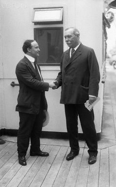 Harry Houdini and Sir Arthur Conan Doyle Shake Hands  Harry Houdini and Sir Arthur Conan Doyle shake hands as Doyle prepares to depart for the UK on the SS Adriatic after his visit to the United States.