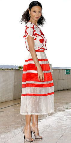 Like Diane Kruger, actress Thandie Newton has the ability to make tricky styles look chic and effortless. Case in point: the red-and-white print Temperley London top and coordinating striped skirt she wears to a Rogue promo event in Cannes.